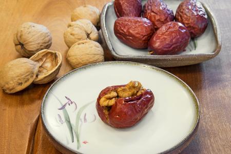 Jujube plus walnut become a very tasty food. Stock Photo