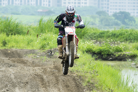 roosting: Motocross on the dirt path