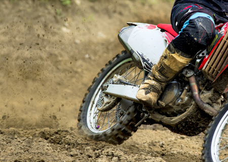 roosting: Motocross on the dirt trail
