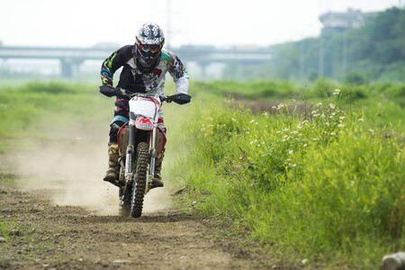 MOTOCROSS RACING ON DIRT PATH