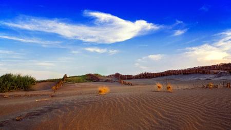 Sand dunes ubder sunset sky, Taipei, Taiwan Stock Photo