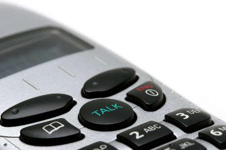 phone handset: macro di un telefono senza fili portatile su bianco, concentrarsi su