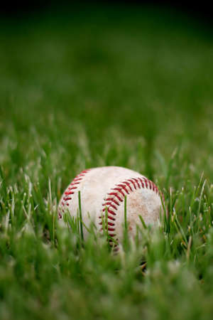 game over, retired baseball in the grass photo