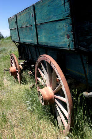 settling: an old wagon in rural wyoming