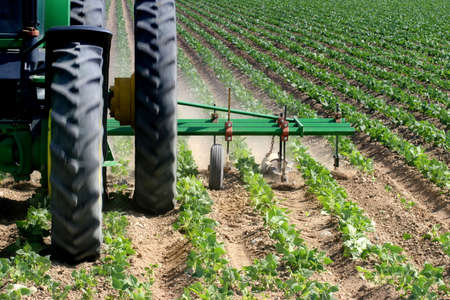 closeup of a tractor plowing the field Stock Photo