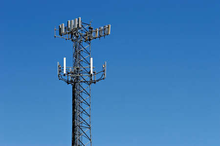 interference: telecommunication tower against a clear blue sky Stock Photo