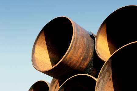 a set of large, used and rusting steel pipes Stock Photo - 217876