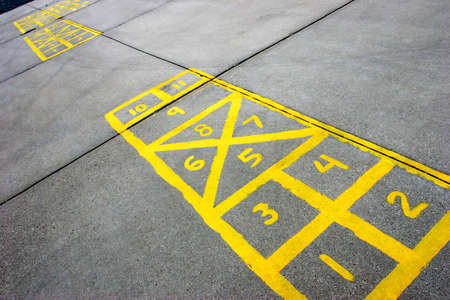 hopscotch: yellow hopscotch boards at a schoolyard