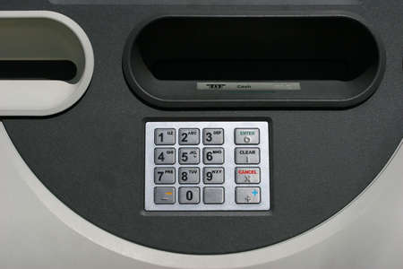 drive through: atm, automated, teller, machine, bank, banking, finance, financing, money, dollars, cents, drive, through, financial, industry, business, commerce, commercial, keypad, keys, input, pin, code, enter, security, cash, withdraw, braile, enter, clear, cancel, Stock Photo