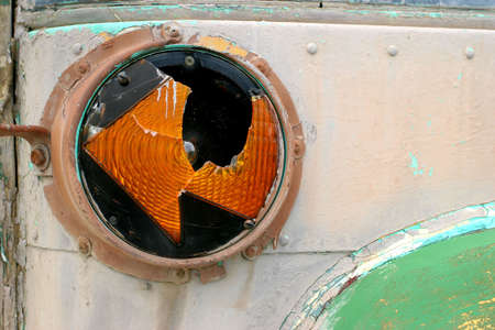 transportaion: the broken blinker of an old and abandoned small bus
