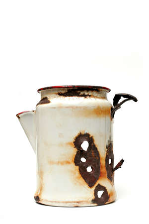 pot hole: a white, metal coffee pot - apparently used by someone as target practice at some point. it was found laying in the middle of nowhere, wyoming... now serves as a vase, lol.