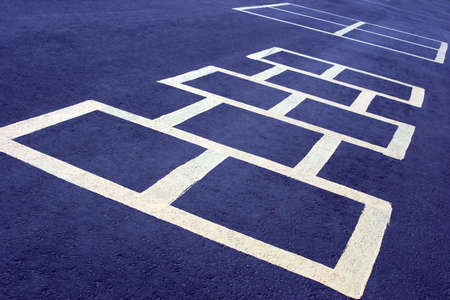hopscotch: hopscotch game at a school, white board on blue
