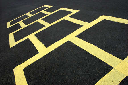 hopscotch jumping game at a school, yellow on black photo