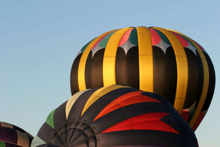cody: hot air balloons inflating at the wild west balloon fest in cody, wyoming