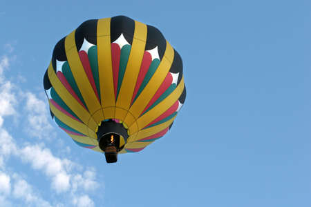 cody: hot air balloon in flight and firing the burner. Stock Photo