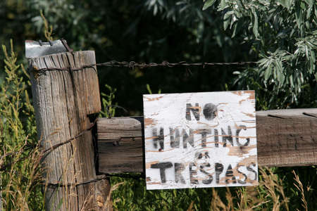 trespass: no hunting or trespassing sign, rural wyoming