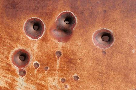 rusting: bullet hole background - rusting metal