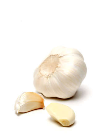 clove of clove: garlic in three stages, macro over white with shallow depth of field and focus on front clove