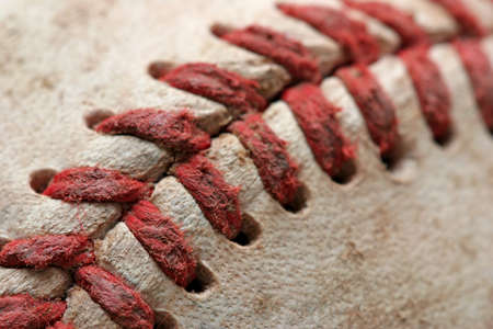 homerun: baseball macro abstract with shallow depth of field and focus near the bottom left corner