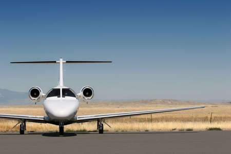 private business jet parked at the airport with copyspace Stock Photo