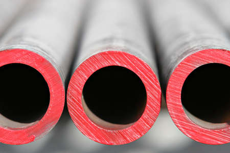 steel pipes - abstract close up of thick steel pipes for use in the oil industry. red paint indicates level of hardness.shallow depth of field.