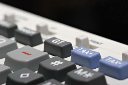 adding: adding machine  calculator with focus on the tax plus button