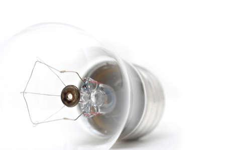 lightbulb, highkey macro shot over white. shallow depth of field with focus on tube.