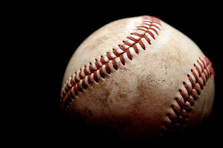 homerun: used baseball macro over black, shallow depth of field