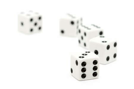 highkey: dice macro, highkey over white with focus on front dice. shallow depth of field.