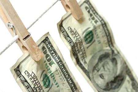 delito: dinero en ropa - el blanqueo de dinero. de cerca con limitada profundidad de campo, se centran en la parte posterior de la primera ley 100 Foto de archivo