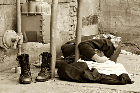 homeless man, sleeping in an alley. converted to add to mood of the image.