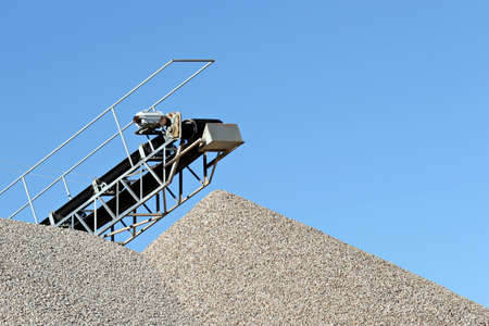 cement pile: conveyor over heaps of gravel at an industrial cement plant
