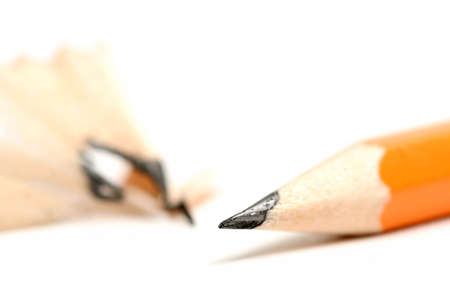 pencil sharpened with shaving blurred in the background. focus on tip with shallow dof photo