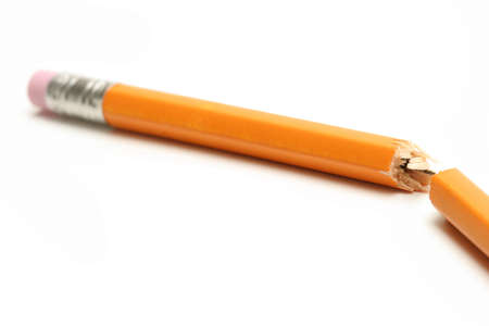 snapped: broken pencil - shot over white with shallow dof and focus on break