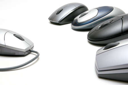 corded: wireless mice - four wireless mice, revolution against the old and outdated corded models. highkey shot over white, focus on left mouse.