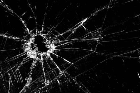 disrepair: broken glass - cracked with hole over black Stock Photo