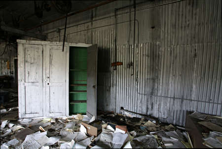 shambles: abandoned industrial workshop in natural lighting - dirty mess left behind Stock Photo