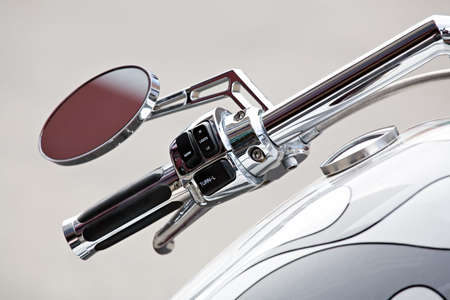 switches: motorcycle - chopper details, handlebar and gas tank closeup, shallow depth of field with focus on switches