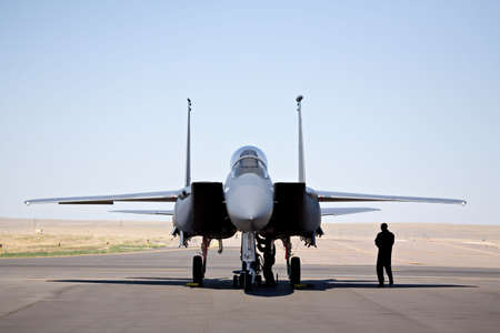 united states air force: military aircraft - F-15 strike eagle on tarmac with pilot and technician