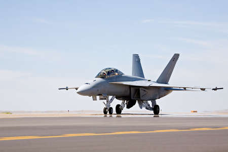 F-18 Hornet military fighter aircraft taxis for takeoff Stock Photo - 492331