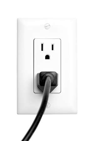power outlet with plugged in cord, closeup isolated on white. limited dof, focus on outlet. photo