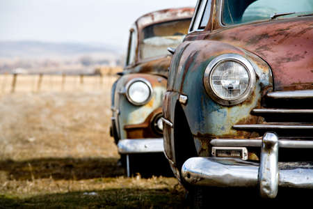 rusted: vintage car - two abandoned vintage cars in rural wyoming