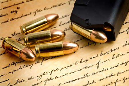 bullets and modern loaded 9mm clip over the bill of rights, focus on the right of the people to keep and bear arms photo