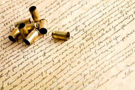 casings: bullets on the bill of rights - the right to bear arms - spent casings, macro with focus on rightmost casing