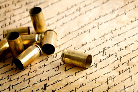 casings: bullet casings on bill of rights - spent casings, macro with limited dof Stock Photo