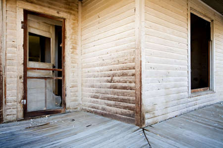 supposedly: patio of an old abandoned, supposedly haunted house in rural wyoming Stock Photo