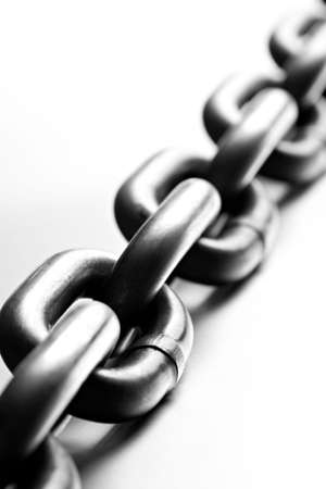 chain macro on cold brushed metal, heavy duty chain with limited dof and copypace Stock Photo