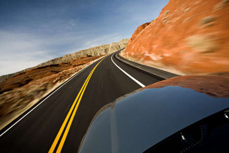 car driving on road through the Bighorn Canyon in Wyoming, motion blur as shot