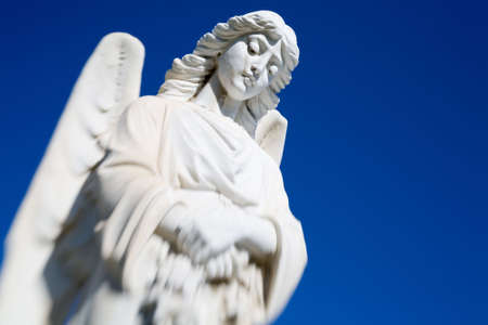 angel cemetery: angel statue at an old rural Montana cemetery, shot against a clear blue sky with room for copy