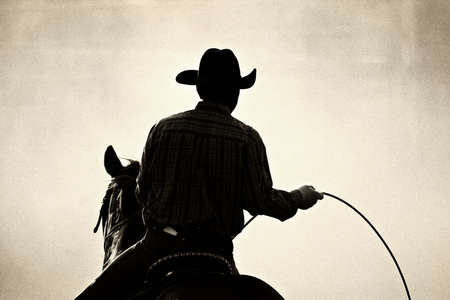 added: cowboy at the rodeo - shot backlit against big cloud of dust, converted with added grain